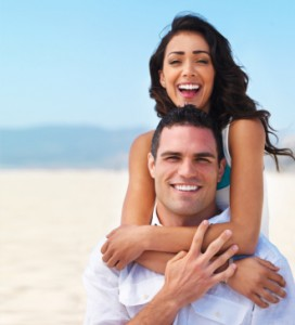 Happy young couple enjoying on beach